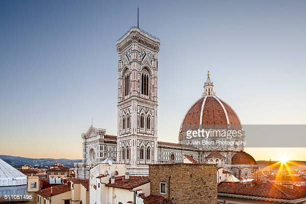 Dawn breaks over the Duomo or Florence cathedral.