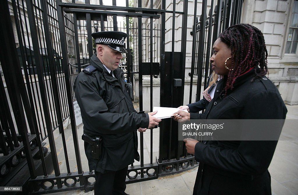 Dawn Butler a British Member of Parliament for Brent in London hands over a letter to a policeman outside 10 Downing Street in central London on May...