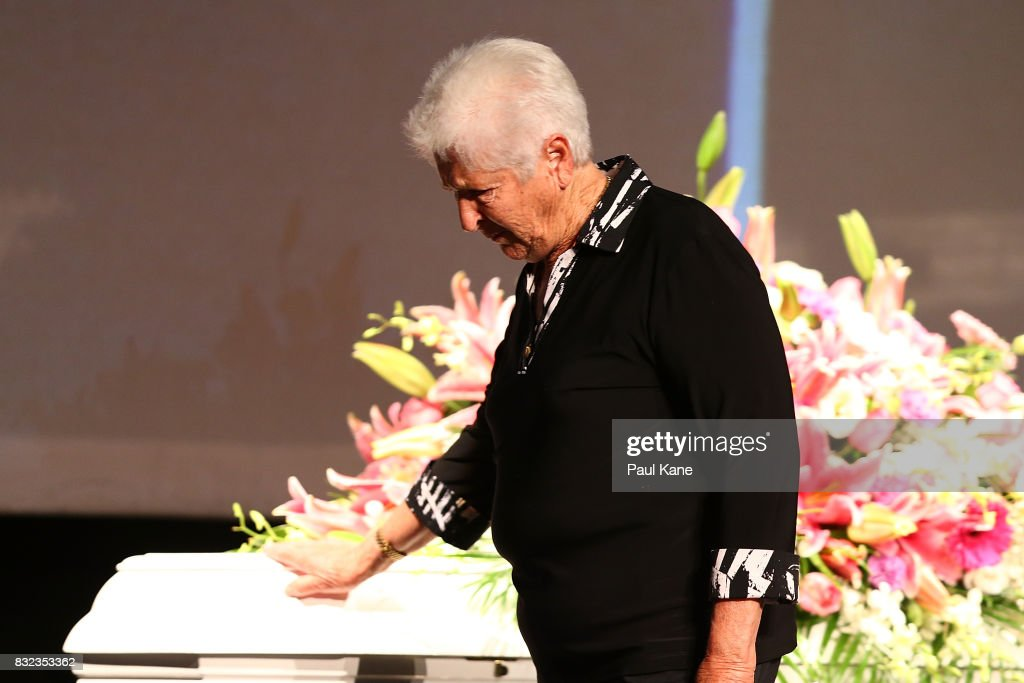 Dawn Fraser places her hand on the coffin after delivering a eulogy during the funeral service for Betty Cuthbert at Mandurah Performing Arts Centre on August 16, 2017 in Mandurah, Australia. Betty Cuthbert was known as 'The Golden Girl' at the 1956 Melbourne Olympics, winning the 100m, 200m and 4x100m relay. After sustaining an injury at the Rome Olympics in 1960, Cuthbert came out of a short-lived retirement to win her fourth Olympic gold medal in the 400m at the 1964 Tokyo Olympic Games. Betty Cuthbert passed away on 6 August 2017, aged 79.