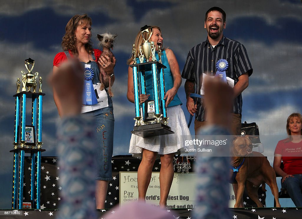 Dawn Goehring (L) and Karen Halligan (C) look on as Miles Egstad (R) of Citrus Heights, California, reacts with his dog Pabst, a boxer mix, after winning the 21st Annual World's Ugliest Dog Contest at the Sonoma-Marin Fair June 26, 2009 in Petaluma, California. Pabst, a four year-old boxer mix won the annual World's Ugliest Dog contest.