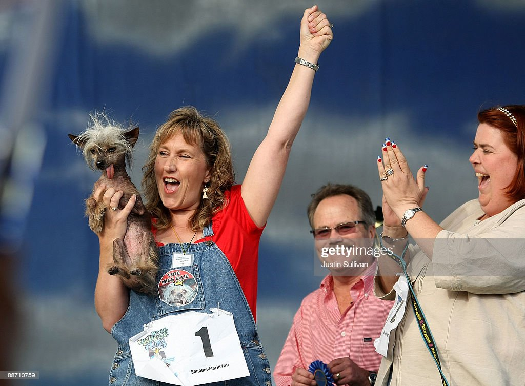 Dawn Goehring of Gatlinburg, Tennesse, reacts with her dog Miss Ellie, a Chinese Crested, after winning the pedigree division of the 21st Annual World's Ugliest Dog Contest at the Sonoma-Marin Fair June 26, 2009 in Petaluma, California. Pabst, a four year-old boxer mix won the annual World's Ugliest Dog contest.