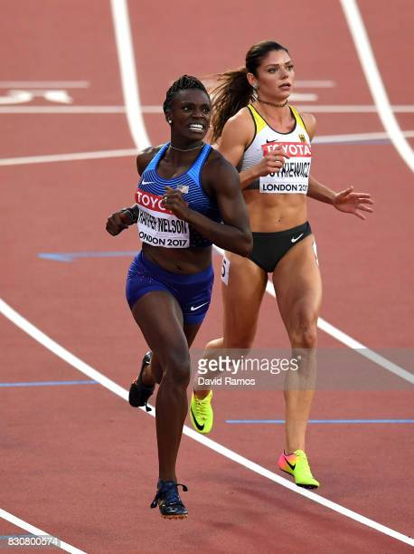 Dawn Harper Nelson of the United States and Pamela Dutkiewicz of Germany compete in the Women's 100 metres hurdles final during day nine of the 16th...