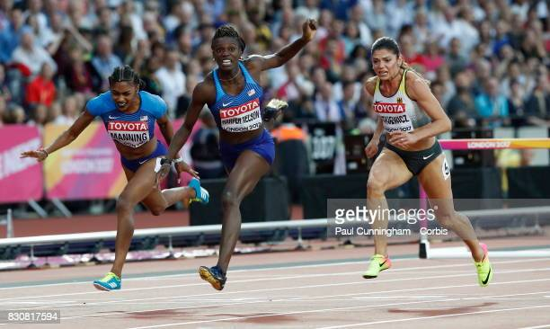 Dawn Harper Nelson of the USA crosses the finish line in 2nd place ahead of Pamela Dutkiewicz of Germany who came 3rd in the Women's 100m Hurdles...