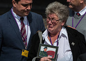 Dawn Holmes holds a picture of a relative killed in the Iraq conflict outside the Queen Elizabeth II conference centre after the outcome of the...