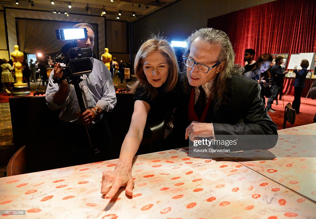 Dawn Hudson CEO of Chief Executive Officer of the Academy of Motion Picture Arts and Sciences points to a lip imprint of actress Lucille ball and...