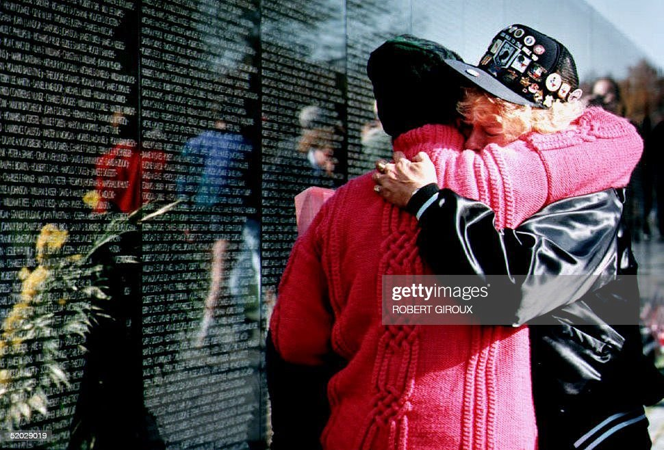 Dawn Lindsey (R) and Patty Skully embrace at the Vietnam Veterans Memorial 09 November 1992. Commermoration activities marking the 10th anniversary of the black granite memorial continue through Veterans Day 11 November.