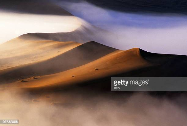 Dawn mist and sand dunes in the Namib Desert