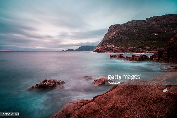 Dawn over Mount Parsons on the east coast of Freycinet Peninsula with Cape Forestier and Lemon Rock in the far distance Sleepy Bay Freycinet National...