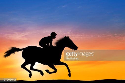 Dawn over professional jockey riding a racehorse