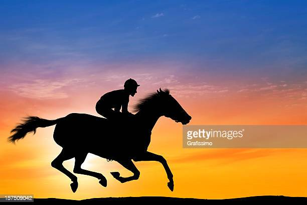 Dawn over professional jockey riding a racehorse