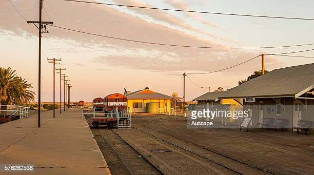Dawn over the disused rail lines at Marree rendered obsolete by the rerouting of the Ghan line between Adelaide to Alice Springs in 1980 and the...