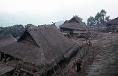 Dawn over the Iko village of Ban Long Muay a twoday walk from Muang Sing in Northern Laos Nowadays the Iko hilltribe people live in bamboo and...