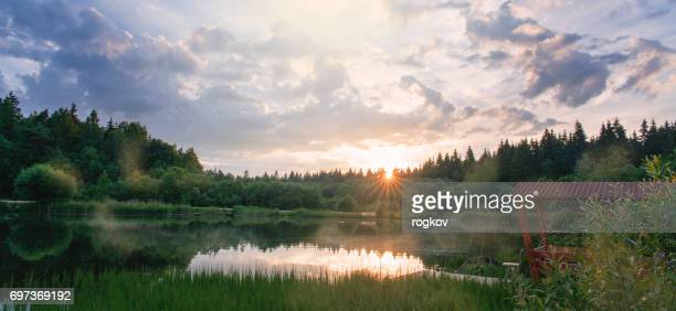 Dawn over the river in silent summer day