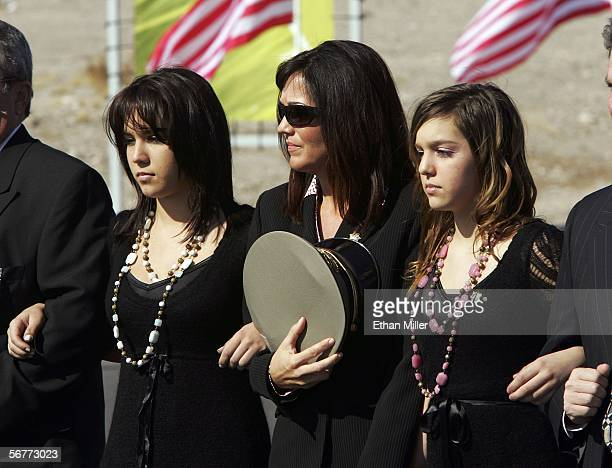Dawn Prendes widow of Las Vegas Metropolitan Police Department Sgt Henry Prendes walks in a procession with his daughters Brooke Prendes and Kylee...