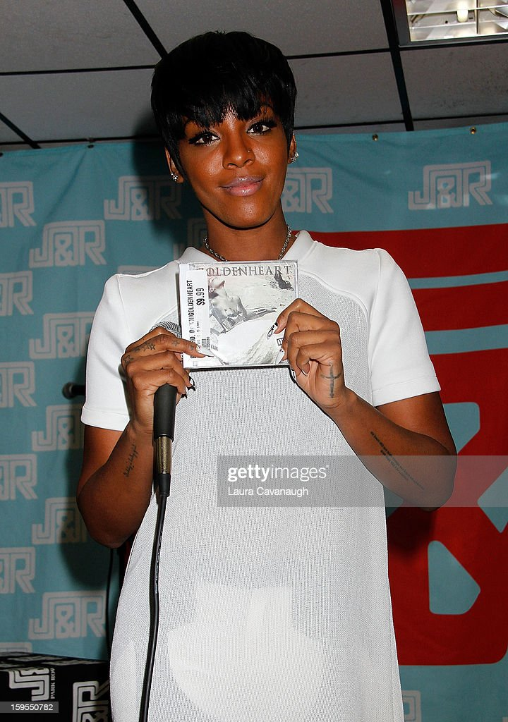 <a gi-track='captionPersonalityLinkClicked' href=/galleries/search?phrase=Dawn+Richard&family=editorial&specificpeople=570573 ng-click='$event.stopPropagation()'>Dawn Richard</a> promotes the new album 'Goldenheart' at J&R Music World on January 15, 2013 in New York City.