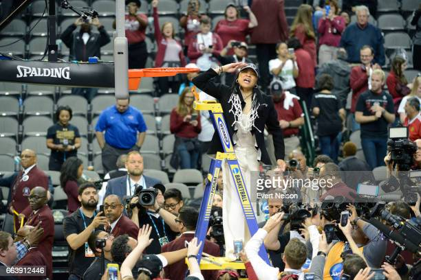 Dawn Staley head coach for South Carolina salutes fans after cutting down the net following their victory over Mississippi State during the 2017...