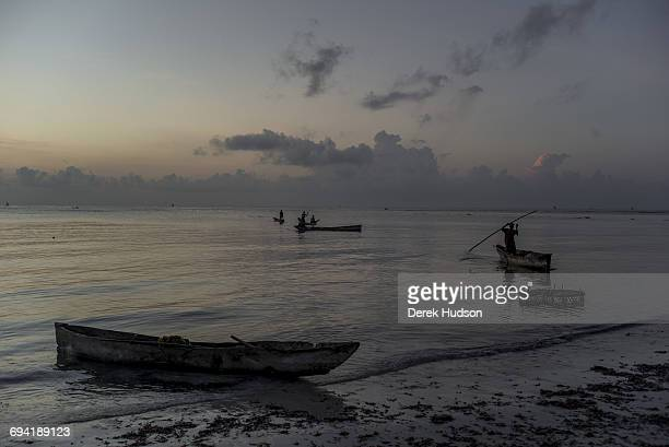 Dawn view of the Indian ocean at Msambweni fishermen prepare their dugout canoes to catch the high tide The small fishing town and constituency of...