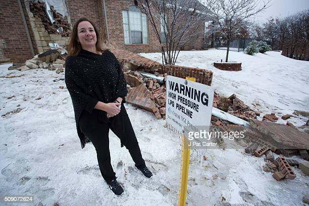 Dawne Sullivan stands besides her home's fireplace December 29 2015 in Edmond Oklahoma Her home was damaged by an earthquake Many people are blaming...