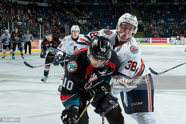 Dawson Davidson of the Kamloops Blazers checks Nick Merkley of the Kelowna Rockets during third period on November 1 2016 at Prospera Place in...