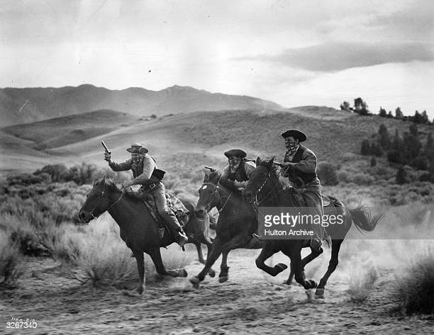 Dawson's henchmen attempt to rob a stagecoach during a scene from the film 'Trail Of The Vigilantes' directed by Allan Dwan