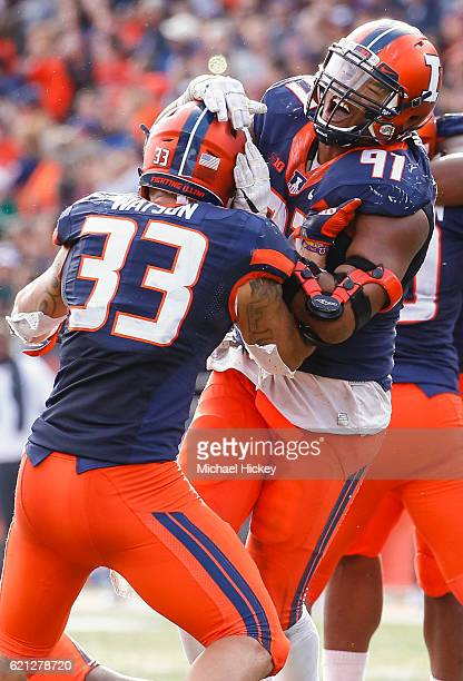 Dawuane Smoot and Tre Watson of the Illinois Fighting Illini celebrates in the closing moments of the game against the Michigan State Spartans at...
