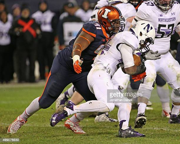 Dawuane Smoot of the Illinois Fighting Illini moves to tackle Justin Jackson of the Northwestern Wildcats at Soldier Field on November 28 2015 in...