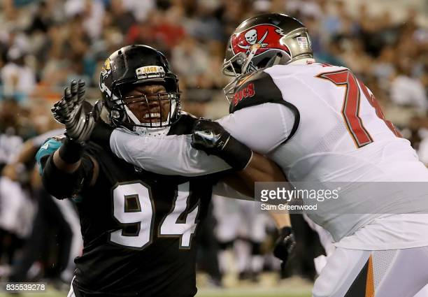 Dawuane Smoot of the Jacksonville Jaguars attempts to run past Donovan Smith of the Tampa Bay Buccaneers during a preseason game at EverBank Field on...