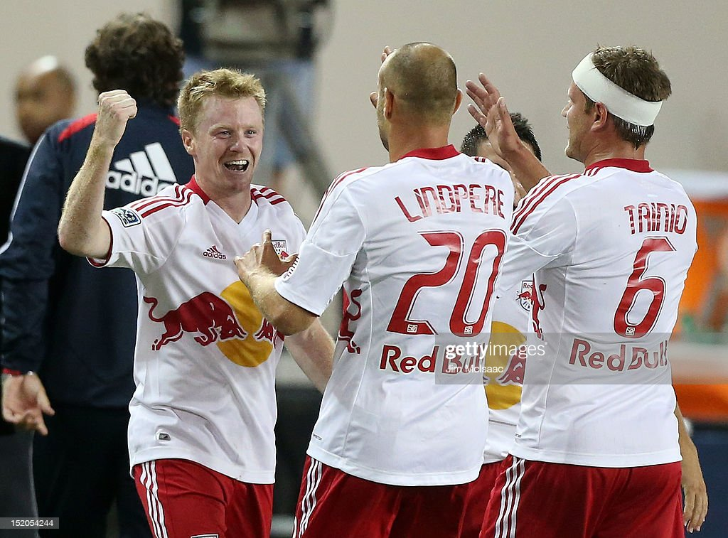 Dax McCarty #11 of the New York Red Bulls celebrates his goal in the second half against the Columbus Crew with teammates Joel Lindpere #20 and Teemu Tainio #6 at Red Bull Arena on September 15, 2012 in Harrison, New Jersey.