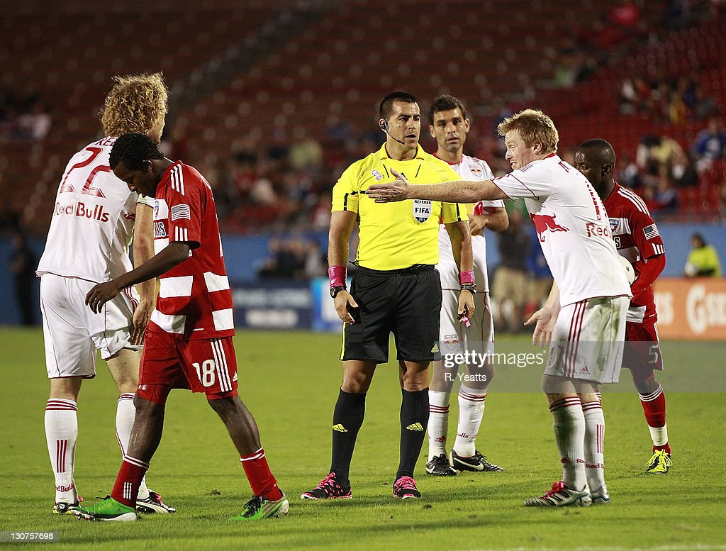 Dax McCarty #11 of the New York Red Bulls reacts to a call by referee Ricardo Salazar against Marvin Chavez #18 of the FC Dallas during the wild card match at Pizza Hut Park on October 26, 2011 in Frisco, Texas.