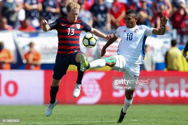 Dax McCarty of USA fights for the ball with Ismael Diaz of Panama during the Group B match between United States and Panama as part of the Gold Cup...