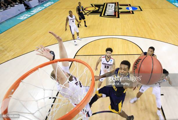 Daxter Miles Jr #4 of the West Virginia Mountaineers goes up against Przemek Karnowski of the Gonzaga Bulldogs during the 2017 NCAA Men's Basketball...