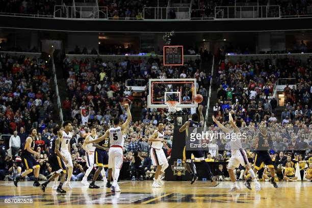 Daxter Miles Jr #4 of the West Virginia Mountaineers misses a shot at the buzzer against the Gonzaga Bulldogs in the second half during the 2017 NCAA...