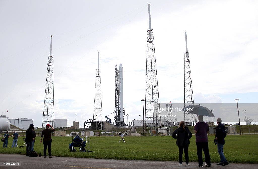 A day after being delayed due to clouds and rain over central Florida the SpaceX Falcon 9 rocket carrying a Dragon supply ship is seen surrounded by...