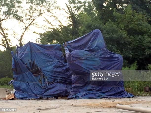 A day after four confederate monuments were removed from public spaces in Baltimore they sit tarped in a cityowned lot awaiting their final...