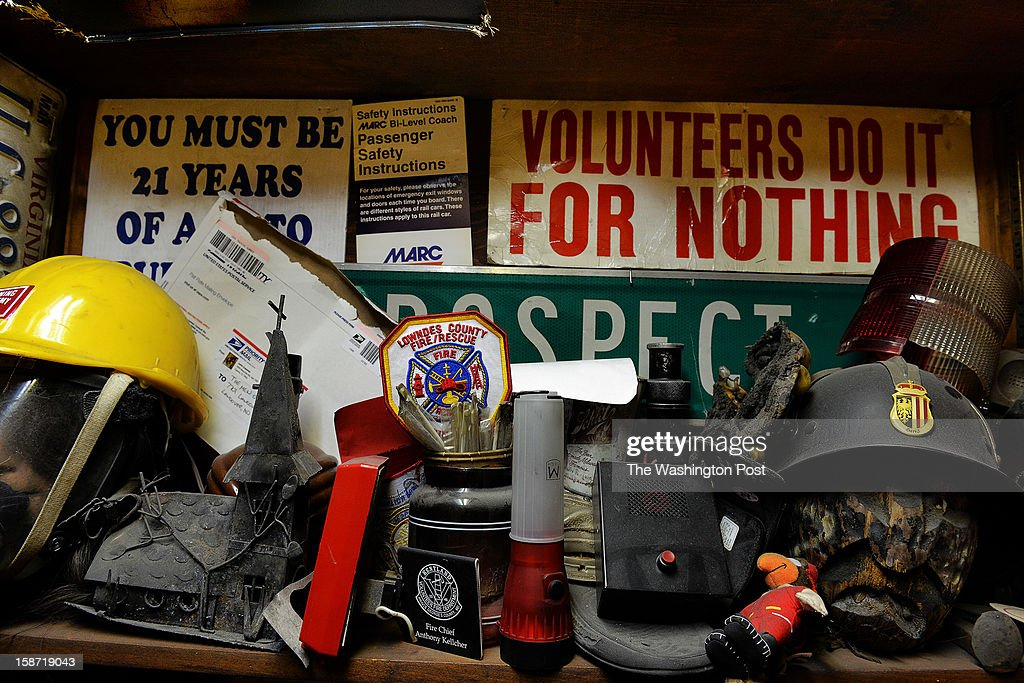 A day after four firefighters were ambushed and shot in upstate NY, a display of memorabilia at Kentlands volunteer fire department on December, 25, 2012 in Landover, MD.