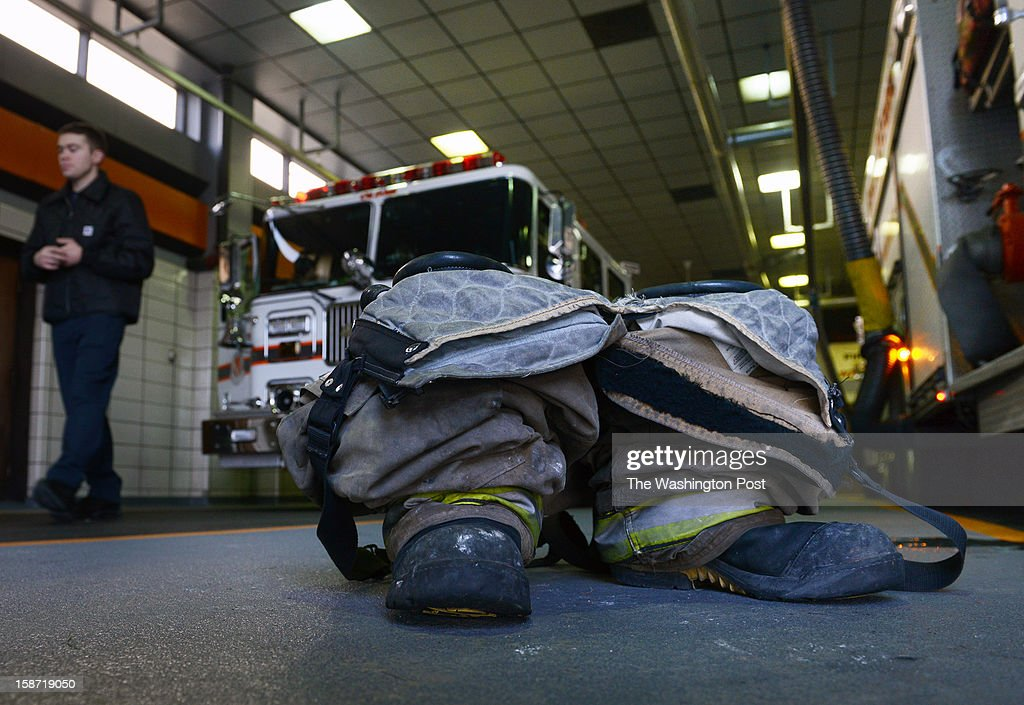 A day after four firefighters were ambushed and shot in upstate NY, a firefighters boots are ready to be used next to a rescue apparatus at Kentlands volunteer fire department on December, 25, 2012 in Landover, MD.