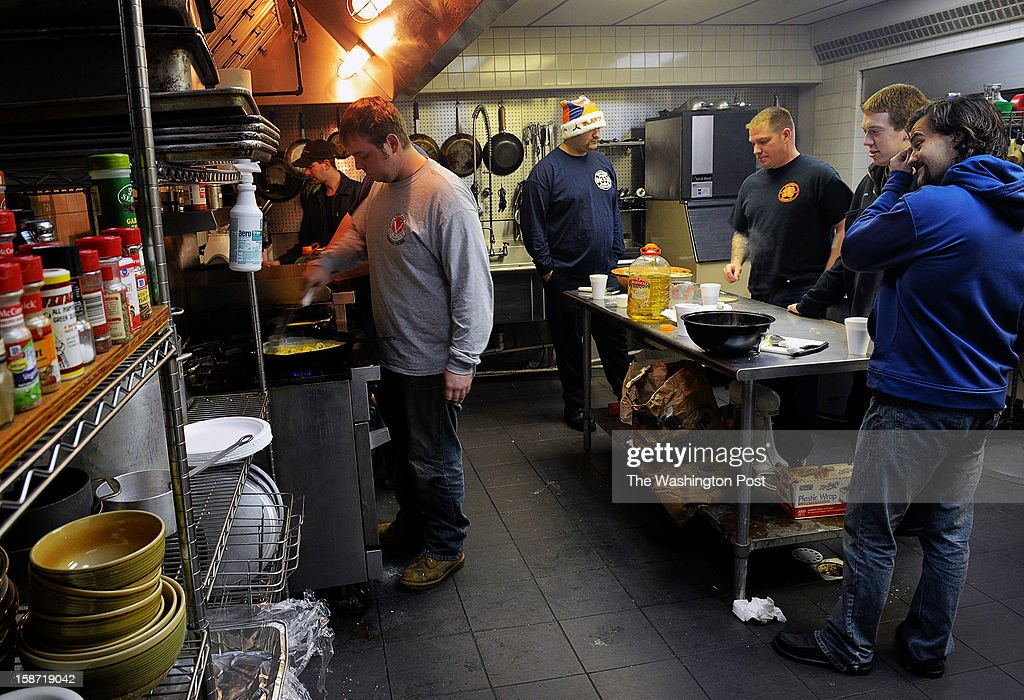 A day after four firefighters were ambushed and shot in upstate NY, firefighters gather in the kitchen at Kentlands volunteer fire department to prepare Christmas breakfast on December, 25, 2012 in Landover, MD.