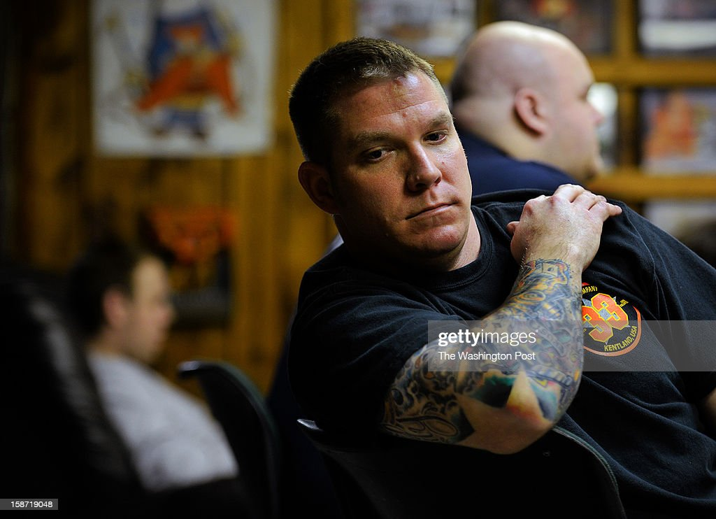 A day after four firefighters were ambushed and shot in upstate NY, firefighter Jason Yates waits for an alarm at Kentlands volunteer fire department on December, 25, 2012 in Landover, MD.