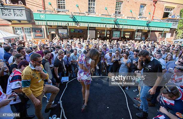 Day at the Glenmore Hotel in the Rocks on April 25 2015 in Sydney Australia 2 up 2 Pennies are placed on a paddle and tossed in the air frantic bets...