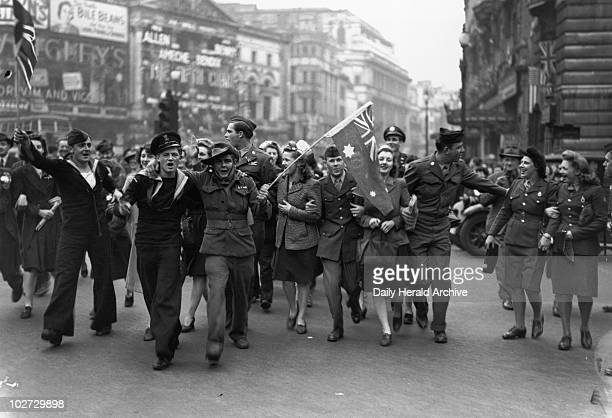 VE day celebrations in Piccadilly London WWII 7 May 1945 A smiling crowd of servicemen and women celebrates Victory in Europe An Australian soldier...