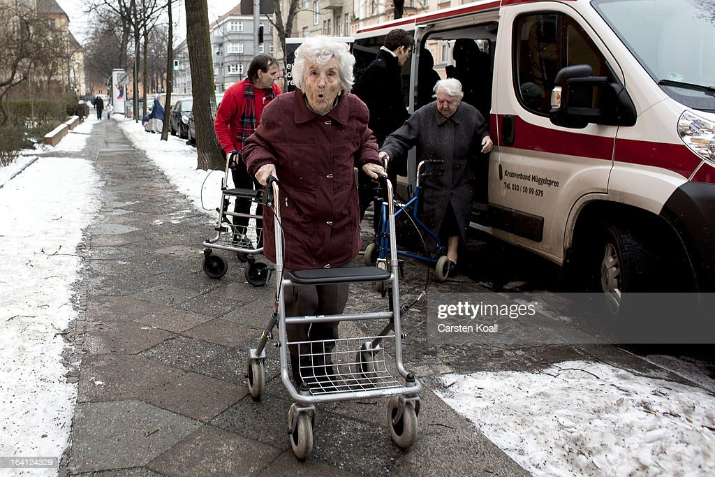 Day guest Helga arrives in the geriatric day care facility of the German Red Cross (DRK, or Deutsches Rotes Kreuz) at Villa Albrecht on March 18, 2013 in Berlin, Germany. A great number of senior Citzens struggle with various forms of dementia at Villa Albrecht. The German Red Cross dates its origin back to 1863 with the founding of the Wuerttembergischer Sanitaetsverein, a medical association that provided care to wounded soldiers. Today the German Red Cross has four million members nationwide and is active in international aid and social care.
