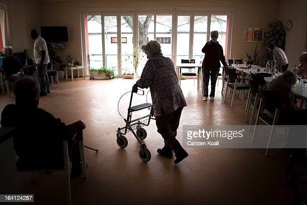Day guest Helga crossed the room in the geriatric day care facility of the German Red Cross at Villa Albrecht on March 18 2013 in Berlin Germany A...