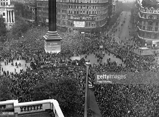 VE day held to commemorate the official end of Britain's involvement in World War II is celebrated by crowds at Trafalgar Square in London