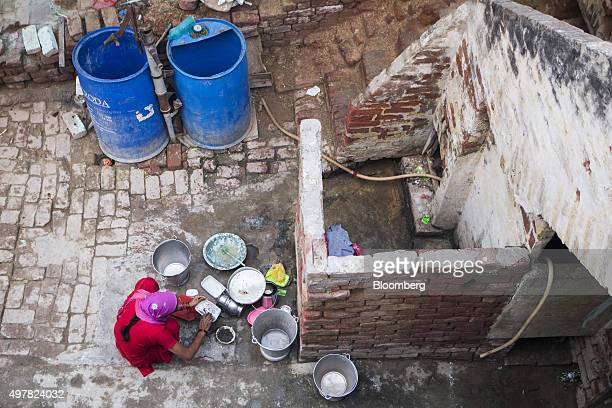 Day laborer Kamlesh cleans a container at her home in Lahli village Haryana India on Tuesday Nov 3 2015 After years of volunteering for a union in...
