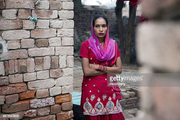 Day laborer Kamlesh stands for a photograph at her home in Lahli village Haryana India on Tuesday Nov 3 2015 After years of volunteering for a union...