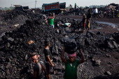 Day laborers load coal into trucks at an open pit coal mine in the Bestacolla Colliery in Jharia Jharkhand India on Sunday April 6 2014 Coal India...