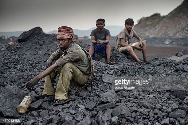 Day laborers take a break from the hard work in the coal mines of Jharia Jharia in India's eastern Jharkand state is literally in flames This is due...