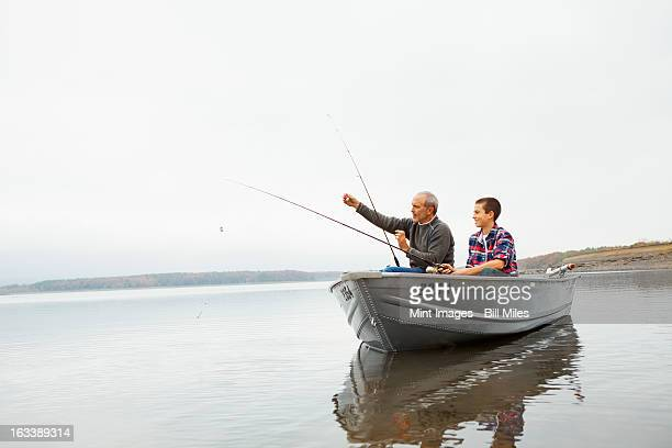 A day out at Ashokan lake. A man and a teenage boy fishing from a boat.