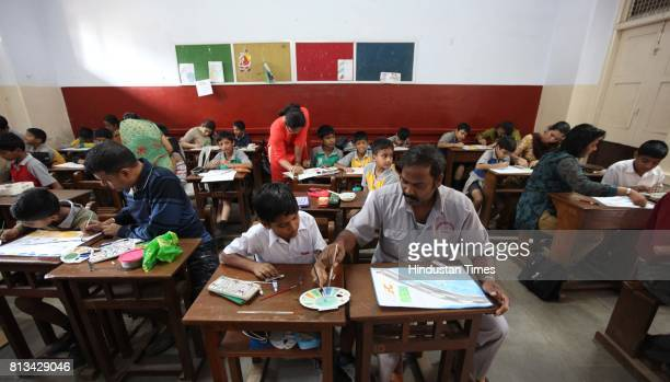 Day Parents and kids participate in Hindustan Times painting competition at Stanislaus High School at Bandra