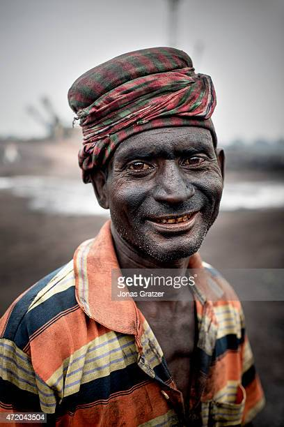 A day time laborer's face is covered with coal dust from the hard work in the coal mines of Jharia Jharia in India's eastern Jharkand state is...
